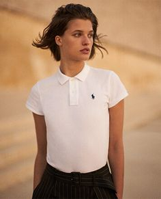 bbf992e27be Woman in white Polo shirt with navy Polo Pony at chest