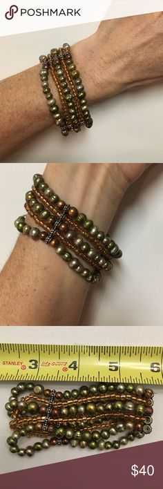 Bespoke Multi-Strand Bracelet Stretch thread for a small to medium wrist only. Real cultured pearls in an olive green. Clear glass beads with a bronze center. Base metal strand guide (the bars). Jewelry Bracelets