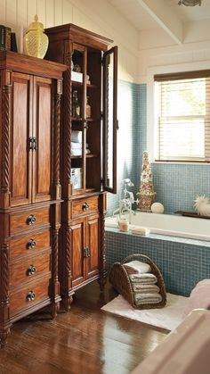This plantation-style bath furniture is perfect for stowing towels, bed linens, and toiletries in a finely outfitted bath.