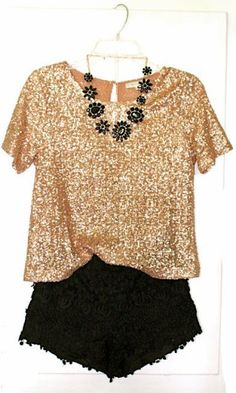 Sparkly gold blouse with black lace shorts and black bejeweled accented statement necklace. Im hoping for a destination NYE for xmas. :)?