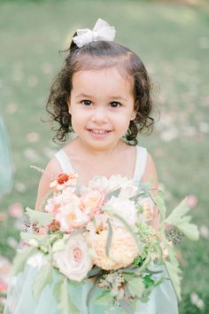 This flower girl is O-M-G adorable: Photography : Richelle Hunter Photography Read More on SMP: http://www.stylemepretty.com/canada-weddings/quebec/montreal/2016/07/20/when-a-wedding-photographer-gets-married-its-all-about-the-details/