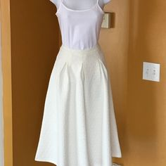 "EGGSHELL QUILTED FULL SKIRT Lovely!! Eggshell color with great detail in the material. A very versatile color. Pairs great with a tank or completely dress it up. 100% polyester. 27"" long. -No trades. Skirts A-Line or Full"