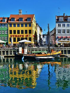 Nyhavn  is a 17th century waterfront, canal and entertainment district in Copenhagen, Denmark.   by judith 74's via flickr