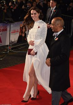 The Duchess of Cambridge stunned on the red carpet this evening in a floor length white dr...