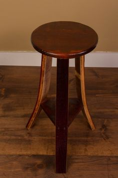 Wine Barrel Wood Stool is made from wine barrel staves and has a very sturdy construction. All stools show off the natural red wine stains and are nice additions to many of our tables and bars. Wine Barrel End Table, Wine Barrel Chairs, Whiskey Barrel Furniture, Wine Barrels, Barrel Bar, Bourbon Barrel, Wine Cellar, Red Wine Stains, Barrel Projects