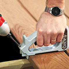A jig and screw kit allows fast installation of decking without pilot holes. The secret of the handy hidden fastener system is an augering screw that hogs out wood as it's driven, along with a special tool that holds it at the proper angle and acts as a board spacer.