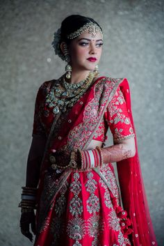 Stunning red bridal lehenga with heavy bridal jewellery in polki and kundan jewellery | WedMeGood||#wedmegood #indianweddings #jewellery #bridaljewellery #polkijewellery #bridallehenga