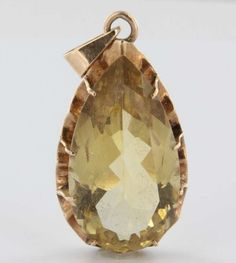 Overview:Offered for sale is a truly superb vintage pendant (circa 1940s to 1950s), crafted in 14k yellow gold. A large estimated 30 carat faceted