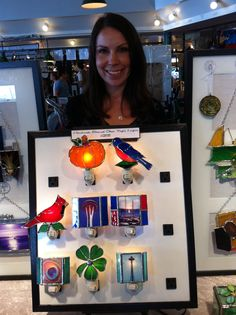 Stained glass nightlights by Dionea Nadir of Lucent Art Glass. Located in the crafts market.