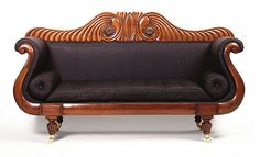 Tasmanian cedar sofa c. 1840:  Cedar (toona ciliata),brass & ceramic castors, horsehair upholstery 115.0 h x 210.0 w x 56.0 d cm  By an unidentified Tasmanian designer & maker, is a fine example of the late neoclassical style of furniture produced in Australia in  mid-19th century. A development from earlier, plainer furniture made during Tasmania's early colonial period reflecting increasing confidence, visual complexity & design eclecticism of production.