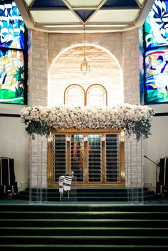 This lucite/acrylic chuppah frame provides a beautiful illusion frame topped with masses of blush and white florals! Photo Credit:  Josh and Aleah photography