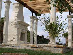 Backyard pergola with fireplace. The columns are gorgeous.