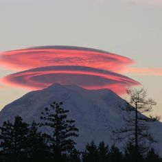 Morning lenticular clouds over Mount Rainier (a stratovolcano), Seattle, WA