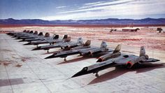 A-12 Oxcarts, originally built for the CIA with USAF markings. The Oxcart was a single seat aircraft while its future USAF SR-71 Blackbird variant was a dual seat aircraft. Note the additional canopy on the second A-12 in the photograph.