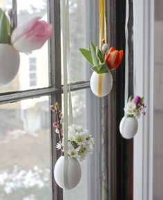 pretty blown eggs used as hanging vases