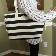 """Gorgeous Nylon Stripped Shopper Double leather braided,leather logo patch,snap closure             Two front wall pockets, one back wall zipper pocket, key keeper                                Measures approximately 17"""" W x 12"""" H x 6"""" D with a 10"""" strap drop                                               Body 100% nylon;bottom/lining 100% cotton ; Trim 100% leather Dooney & Bourke Bags Shoulder Bags"""