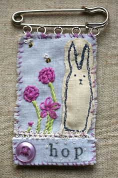 Hop the Bunny Rabbit Textile Linen and Silk Embroidered Brooch on Kilt Pin.love the little rings to mount the piece on the kilt pin! Textile Jewelry, Fabric Jewelry, Textile Art, Jewellery, Diy Jewelry, Free Motion Embroidery, Embroidery Applique, Embroidery Stitches, Freehand Machine Embroidery