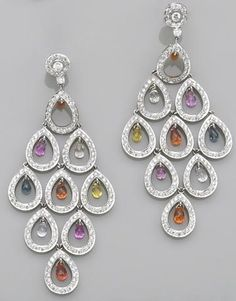 A pair of multi-color sapphire, diamond and eighteen karat white gold earrings