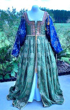 Italian Renaissance Gown Deep Emerald Green Satin Brocade Chinese Motif  Removable Navy Blue Sleeves And Saffron Hat. $165.00, via Etsy.