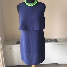 H&M Office to evening out dress Navy blue dress with cutoff at the Breast (per pic. #2) . 100%polyester with side hidden zipper. Never worn. Pair with a blazer and take it from office to evening out. Dress is 100%polyester and machine washable. It doesn't have a liner so a slip or shape wear underneath may be necessary. H&M Dresses Mini
