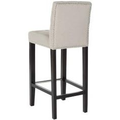 @Overstock.com - Safavieh Noho Beige Linen Nailhead Trim Bar Stool - This Noho barstool offers simplicity in design. The seat is made of soft beige linen, subtle bisquit tufting and individual nailhead trims around the bottom and back of the barstool.  http://www.overstock.com/Home-Garden/Safavieh-Noho-Beige-Linen-Nailhead-Trim-Bar-Stool/6971978/product.html?CID=214117 $194.99