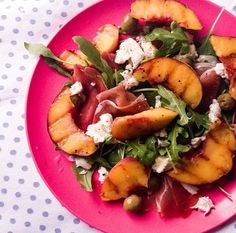Rocket salad with mozzarella, proscuitto, grilled peaches and olives