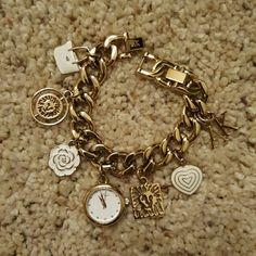 Elegant charm bracelet watch Excellent used condition. Beautiful goldtone bracelet watch with charms. Can be adjusted by removing 2 closure links. Needs a new battery. Anne Klein Accessories Watches