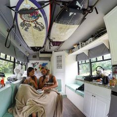 These surfers travelled all the way across the country in this cool bus buildout! Love the DIY bus interior and they did it on a budget!