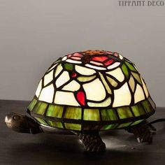 Very beautiful tiffany Lamp. Look at the photos and note the splendid colours, the fine finishing, and exquisite design