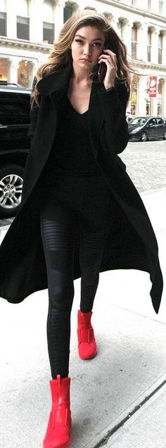 Who made Gigi Hadid's red sneakers, silver chain handbag, and black leggings?