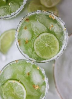 These green goddess margaritas could not be more perfect for Saint Patrick's Day! They are made with fresh cucumber and lime, lots of tequila and salt on the rim. They are garnished with edible gold leaf for a fun little sparkle and they taste super refreshing!