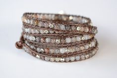 Wrap Bracelet -Brown Cord and Gray / Brown Agate Stone Our Thinking Behind The Design This wrap bracelet wraps 5 times and is made with pearls. This bracelet is great for the earthier look. It is a pe