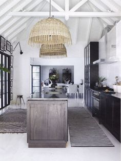 white floors. white beams. vintage runners and straw pendants. love.