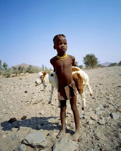 Himba boy and goat, near the Skeleton Coast, Namibia