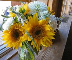 Dahlias, sunflowers in mason jars