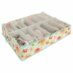 """Canvas under-bed shoe organizer with space for 12 pairs of shoes and an ikat floral motif.   Product: Shoe organizerConstruction Material: CanvasColor: Teal, pink and greenFeatures: Can hold 12 pairs of shoesDimensions: 6"""" H x 29"""" W x 23"""" D"""