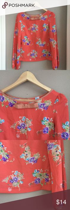 S Moonlight Bow Detail Blouse S Moonlight Bow Detail Blouse. Excellent preowned condition. Muted tangerine orange, delicate floral pattern, with dusty rose trim. Feminine and flirty detailing. You'll feel so pretty in this! moonlight Tops Blouses