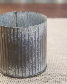 The weathered metal surface of our galvanized tin vases have been perfectly aged and then sealed to protect them. Additionally, each vessel features an interior seal that will prevent leakage if used with floral arrangements. Spanish Tile Roof, Corrugated Tin, Tin Flowers, Aging Metal, Thing 1, Church Design, Container Flowers, Galvanized Metal, Metal Tins
