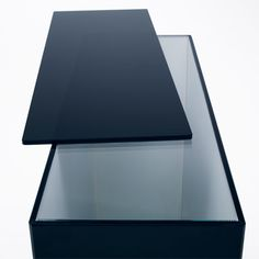 Nendo shifts shelves and surfaces for Slide glass furniture.