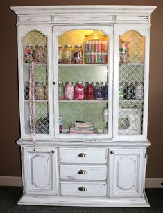 Turning an old wood china cabinet into a gorgeous white shabby chic craft storage. by elisabeth