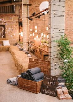 Industrial Lighting & Basket Full of Blankets - Hannah Duffy Photography | New Gen Films | Charlie Brear Peyton Dress & Augustine Skirt | DIY Rustic Wedding at Grove Barn Wedding Venue in the Vale of Belvoir | Dessy Group Bridesmaid Dresses