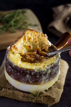 This classic French Onion Soup has a rich, silky broth made from thinly sliced onions, butter, white wine, beef broth, fresh thyme and bay leaves.