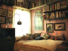 Awesome wallpaper behind a great idea for storing books in a guest bedroom.