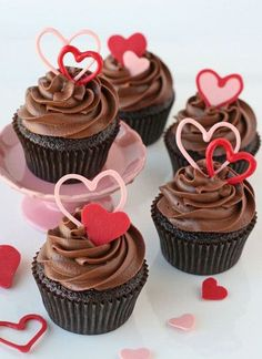 Chocolate cupcakes are a classic dessert, so why not dress them up with some heart shaped toppers for Valentine's Day? If you're in a time bind, just use store-bought cupcakes! Valentine Day Cupcakes, Heart Cupcakes, Valentines Day Desserts, Valentine Treats, Pink Cupcakes, Hydrangea Cupcakes, Valentine Heart, Lemon Cupcakes, Kids Valentines