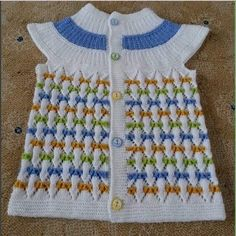 We have compiled 100 crochet baby vest pattern samples. See all of 40 crochet baby vest patterns. Browse lots of Free Crochet Patterns.This Pin was discovered by ayt Crochet Baby Jacket, Baby Sweater Knitting Pattern, Crochet Vest Pattern, Knit Baby Sweaters, Crochet Baby Booties, Sweater Knitting Patterns, Girls Sweaters, Knit Patterns, Baby Vest