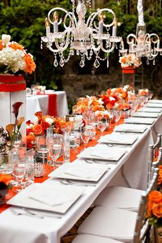Beautiful orange and white wedding tablescape...  www.tablescapesbydesign.com https://www.facebook.com/pages/Tablescapes-By-Design/129811416695