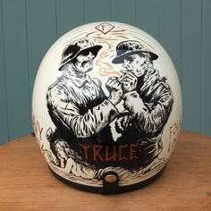 "My custom painted Biltwell Helm for the pure sludge ""Heavy Heads"" show this saturday (27th Sept). ""Truce"". Folklore Branded. - Adi Gilbert"