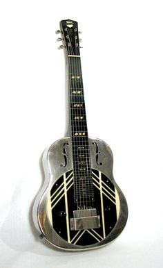 1930's National Silvo Lap Steel Guitar / Nachokitty on Etsy, I know a lot of people who would love this.