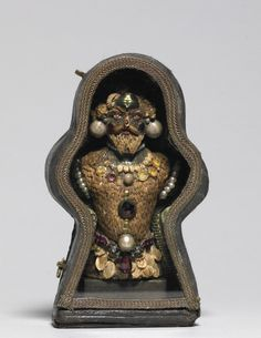 """This is a rare example of a kind of bizarre composite figure that achieved popularity around 1600, especially in Milan.  Made of materials ranging from seeds to a beetle abdomen to pearls, around a wax core, this curious figure exemplifies the notion of human beings as encompassing all the virtues and frailties of the physical world. """