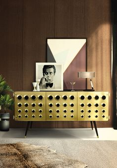 Monocles is a vintage sideboard made in wood with brass finishes. This retro sideboard inspired in the 50's is perfect for a urban space.